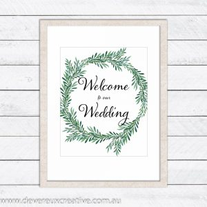 green wreath welcome to our wedding sign