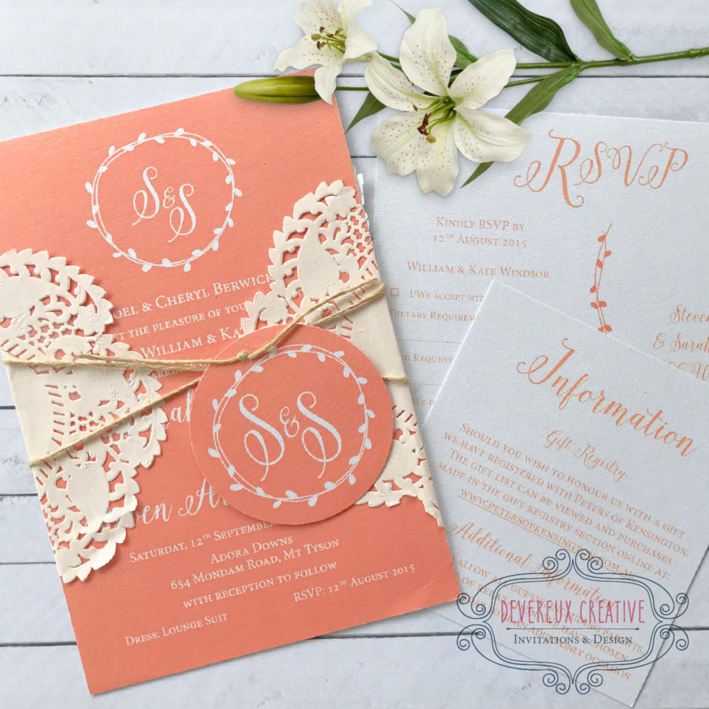 coral wedding invitation with doiley