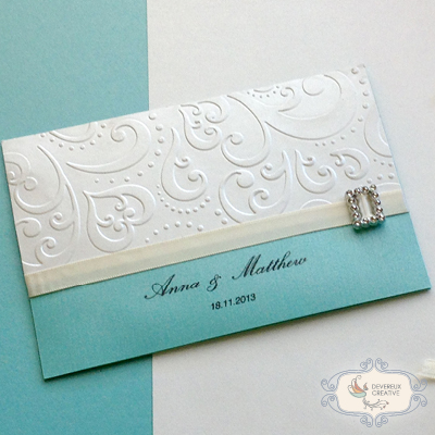 modern wedding invitation with embossing, ribbon and buckle