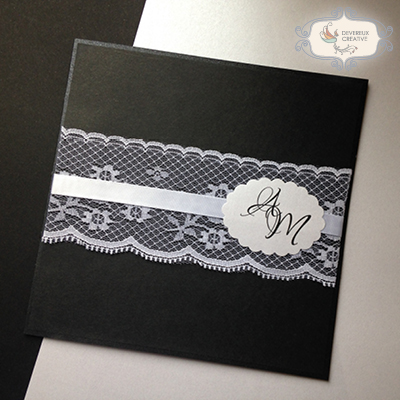 modern wedding invitation with lace and ribbon