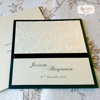 Modern wedding invitation with embossing and ribbon