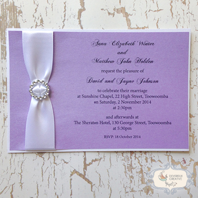 modern wedding invitation with ribbon and buckle