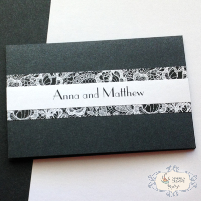 Modern wedding invitation in black and white with paper lace