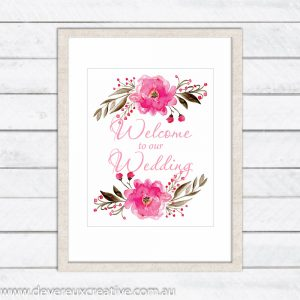 pink floral spray welcome to our wedding sign