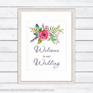 pink and purple floral spray welcome to our wedding sign